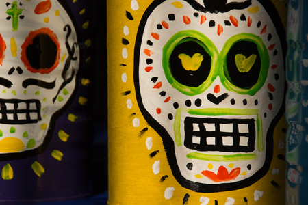 Photograph of some skulls and mexican symbols of traditional day of the dead celebration
