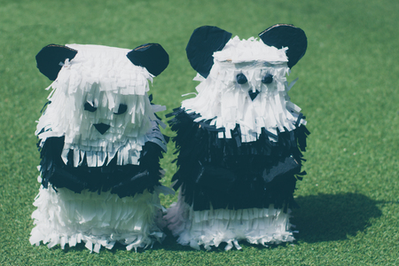 Photograph of a pair of pandas mexican pinatas handcrafts