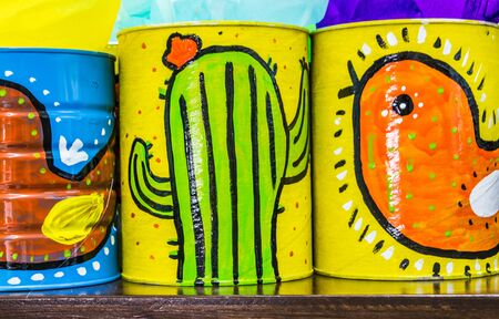 Photograph of some metal cans with mexican symbols