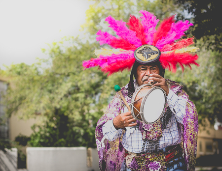 MONTERREY, NUEVO LEON  MEXICO - 11 12 2017: Mexican traditional indigenous musician man perfomrming on street