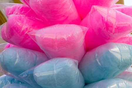 Photograph of some colorful sugar cotton candy in plastic bags Lizenzfreie Bilder