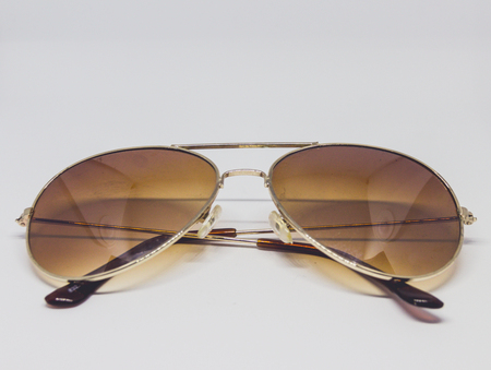 Photograph of a pair of sunglasses in lightbox