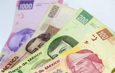 Monterrey, NL Mexico - 04 03 2018: Photograph of  mexican bills of diferent values Редакционное