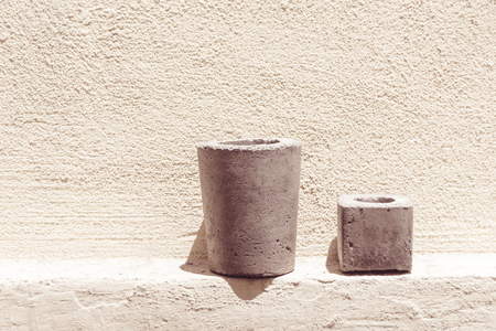 Photograph of some cement or concrete pots