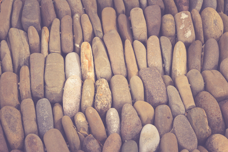 Photograph of a rounded river rocks background 版權商用圖片