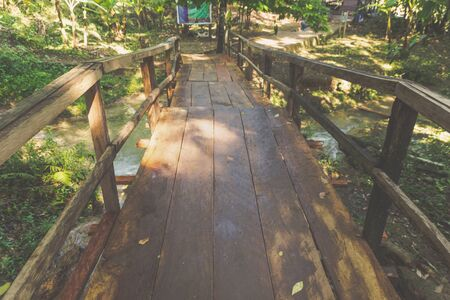 Photograph of a wooden bridge in a forest Stockfoto
