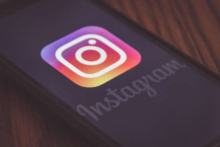 MONTERREY, NUEVO LEON / MEXICO -  09 06 2020: Photograph of  Instagram logo displayed on cellphone on wood table