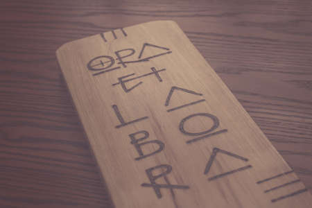Photograph of a handcraft of a latin phrase on wood, that means: Pray and work