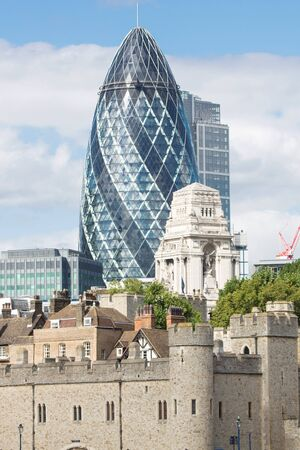 forground: In the forground the picture shows the wall of the London Tower. In the background there is the famous Gherkin tower. Editorial