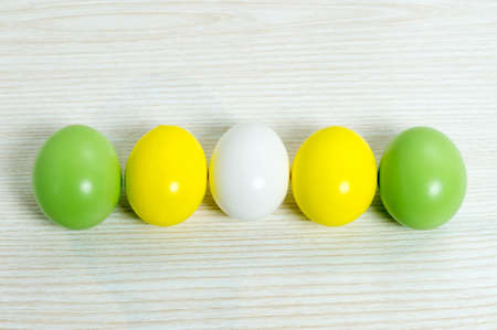 the color of silence: Different colored easter eggs on a wooden background