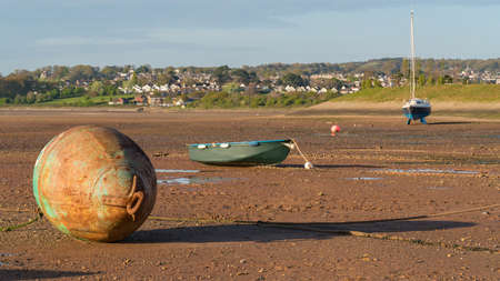 Low tide, ships and a buoy, Exmouth harbour, Devon, England, UK