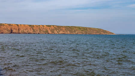 Filey Brigg, seen from Filey, North Yorkshire, UK Stock Photo