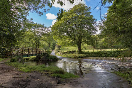 Flooded Ford and Footbridge in the Yorkshire Dales, Cumbria, UK