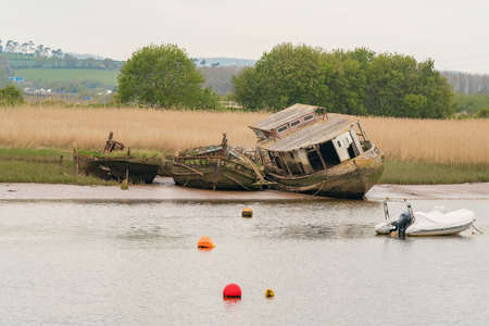 Shipwrecks at the shore of the Exminster Marshes, seen from Topsham, Devon, UK