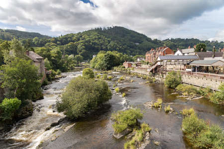 Llangollen, View from Castle St bridge, with the River Dee and the Llangollen railway station, Denbigshire, Wales, UK