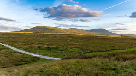 Evening clouds over the Ingleborough hill, near Ribblehead and Ingleton, Yorkshire Dales, North Yorkshire, UK