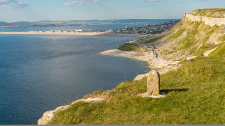 South West Coast Path on the Isle of Portland, looking towards Fortuneswell and Chesil Beach with Weymouth in the background, Jurassic Coast, Dorset, UK Stock Photo