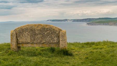 Stone bench at the South West Coast Path, near Emmetts Hill, Jurassic Coast, Dorset, UK Stock Photo