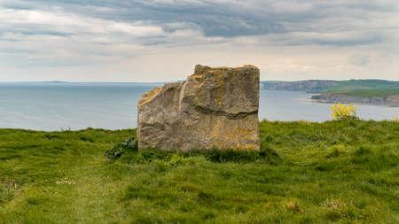 Stone seat at South West Coast Path, near Emmetts Hill, Jurassic Coast, Dorset, UK Stock Photo