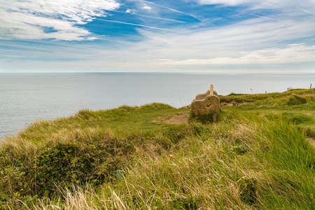 Stone bench at the South West Coast Path near Winspit Quarry, Worth Matravers, Jurassic Coast, Dorset, UK