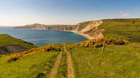 Walking on the South West Coast Path, looking at Worbarrow Bay, near Tyneham, Jurassic Coast, Dorset, UK Stock Photo