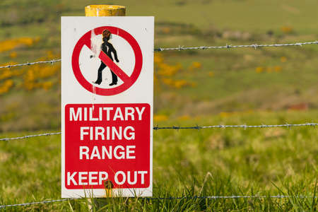Sign: Military firing range keep out, seen on the South West Coast Path between Worbarrow Bay and Brandy Bay, Jurassic Coast, Dorset, UK Stock Photo