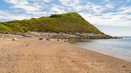 Standing on Worbarrow Bay, near Tyneham, Jurassic Coast, Dorset, UK - looking east Stock Photo