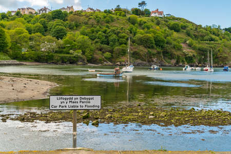 Sign: Car park liable to flooding (English & Welsh), seen in Fishguard, Pembrokeshire, Dyfed, Wales, UK