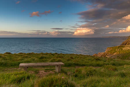 Evening light and clouds between Mwnt and Aberporth, Ceredigion, Dyfed, Wales, UK 写真素材