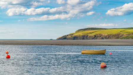 A boat and some buoys at Pembrokeshire coast in Parrog, Dyfed, Wales, UK Stock Photo