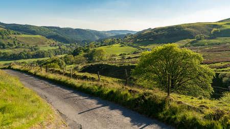 Single lane country road, near Cwmystwyth, Ceredigion, Dyfed, Wales, UK Stock Photo