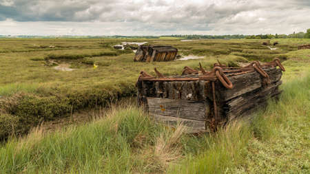 Old pontoons in the marshland near the River Crouch, Wallasea Island, Essex, England, UK Stock Photo