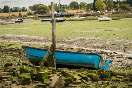 Boats at low tide in Lower Halstow, Kent, England, UK Stock Photo
