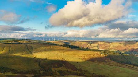 Wind turbines and clouds, Mynydd Tyle Goch in Rhondda Cynon Taf, Mid Glamorgan, Wales, UK Фото со стока - 93360588