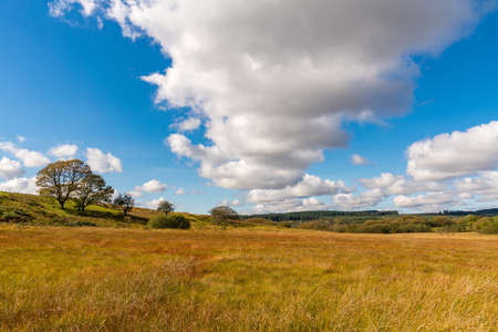 Clouds over a field near Ystradfellte in Powys, Wales, UK Stock Photo