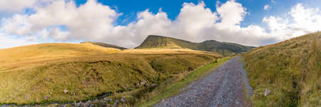 Clouds over the Bannau Sir Gaer (Picws Du) in the Carmarthen Fans in Carmarthenshire, Dyfed, Wales, UK Stock Photo