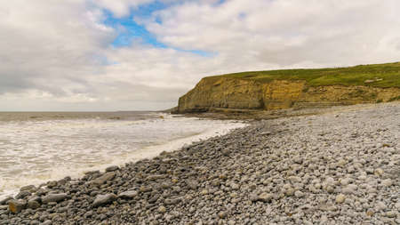 Stones and cliff in Dunraven Bay, Vale of Glamorgan, Wales, UK