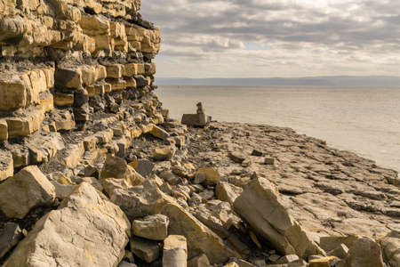 The stones and cliffs of Monknash Beach, Vale of Glamorgan, Wales, UK - with the Bristol Channel in the background Stock Photo