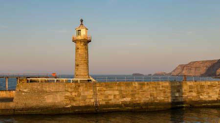 Evening light at the North Sea Coast and Whitby Pier, North Yorkshire, UK