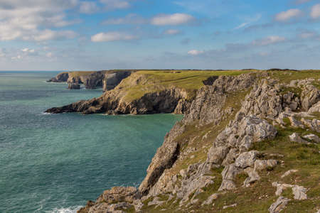 Coast and cliffs at Flimston Bay near Castlemartin in Pembrokeshire, Wales, UK Stock Photo