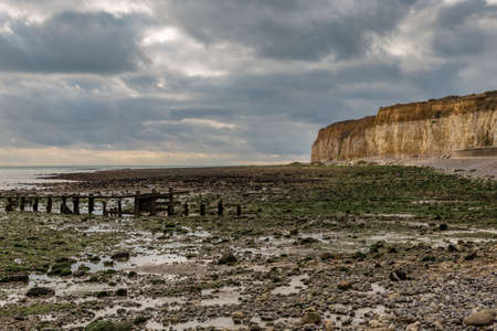 Stones, beach and cliff in Cuckmere Haven near Seaford, East Sussex, UK