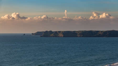 View towards the cliffs and the sea from South Beach in Tenby, Pembrokeshire, Wales, UK