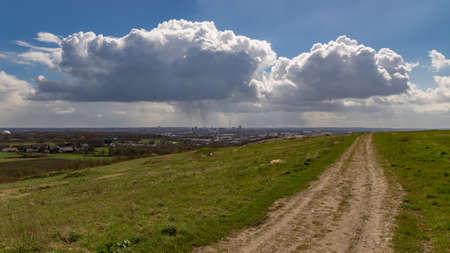 A raincloud over the skyline of Dortmund, Ruhr Area, North Rhine-Westfalia, seen from Deusenberg