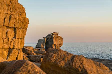 Evening light at Pulpit Rock, near Portland Bill lighthouse, Isle of Portland, Jurassic Coast, Dorset, UK