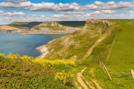 South West Coast Path with a view over the Jurassic Coast and the climb up on Emmetts Hill, near Worth Matravers, Jurassic Coast, Dorset, UK