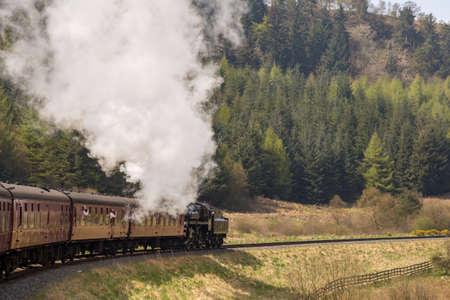 Near Goathland, North Yorkshire, England, UK - May 07, 2016: A train on the The North Yorkshire Moors Railway on the way between Whitby and Pickering