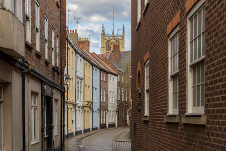 Kingston upon Hull, England, UK - May 02, 2016: Houses in Prince Street with the Hull Minster in the background Editorial