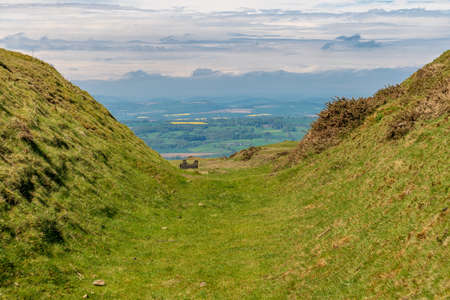 View over the Shropshire landscape from Titterstone Clee near Cleeton, England, UK - with ruins of old Quarry buildings