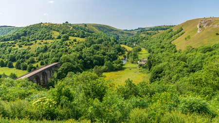 Peak District landscape with the Headstone Viaduct over the River Wye in the East Midlands, Derbyshire, England, UK