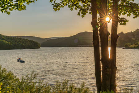 Sunset over the Peak District at the Ladybower Reservoir near Bamford in the East Midlands, Derbyshire, England, UK Stock Photo
